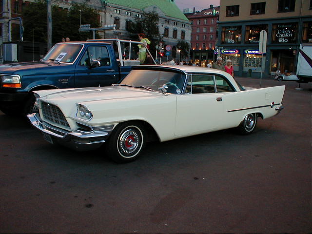 1957 Model of white luxury coupe-Chrysler 300C, exotic car